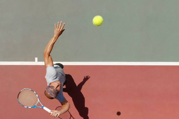 tennis player serving - tennis stock pictures, royalty-free photos & images