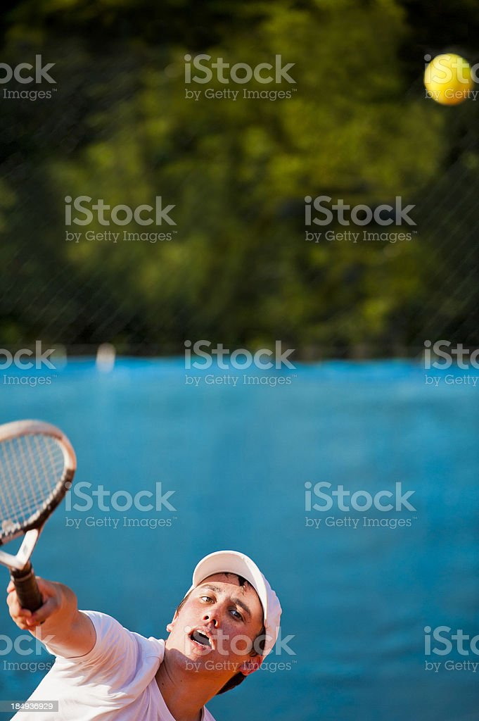Tennis player serving the ball stock photo