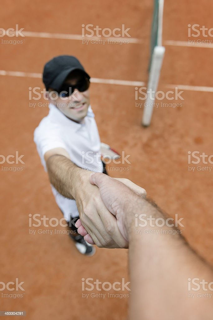 Tennis player shaking hands with chair umpire royalty-free stock photo
