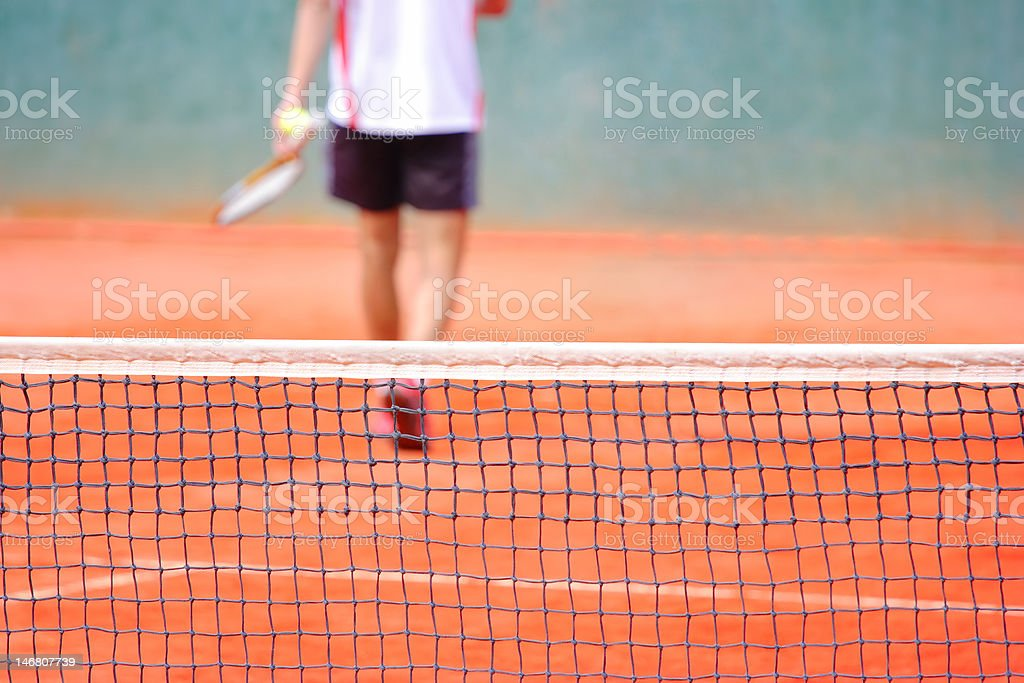 Tennis player walking out of a court stock photo