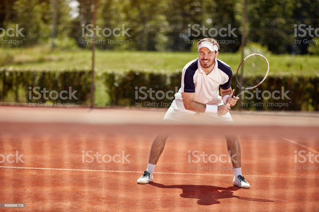 Tennis player with racket stock photo
