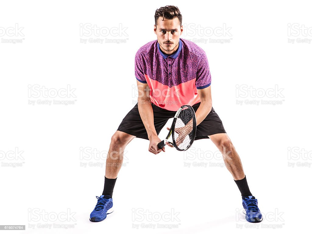 tennis player with racket ready to hit a tennis ball stock photo