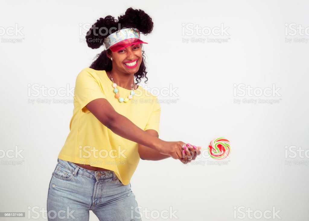Tennis player woman holding spiral wheel lollipop. Ready to beat the ball. stock photo