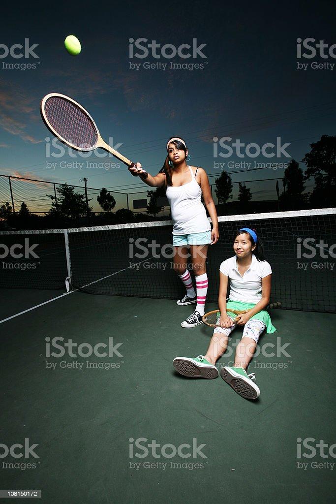 Tennis Players at Night stock photo