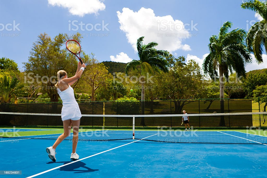 tennis players on a court in the Caribbean royalty-free stock photo