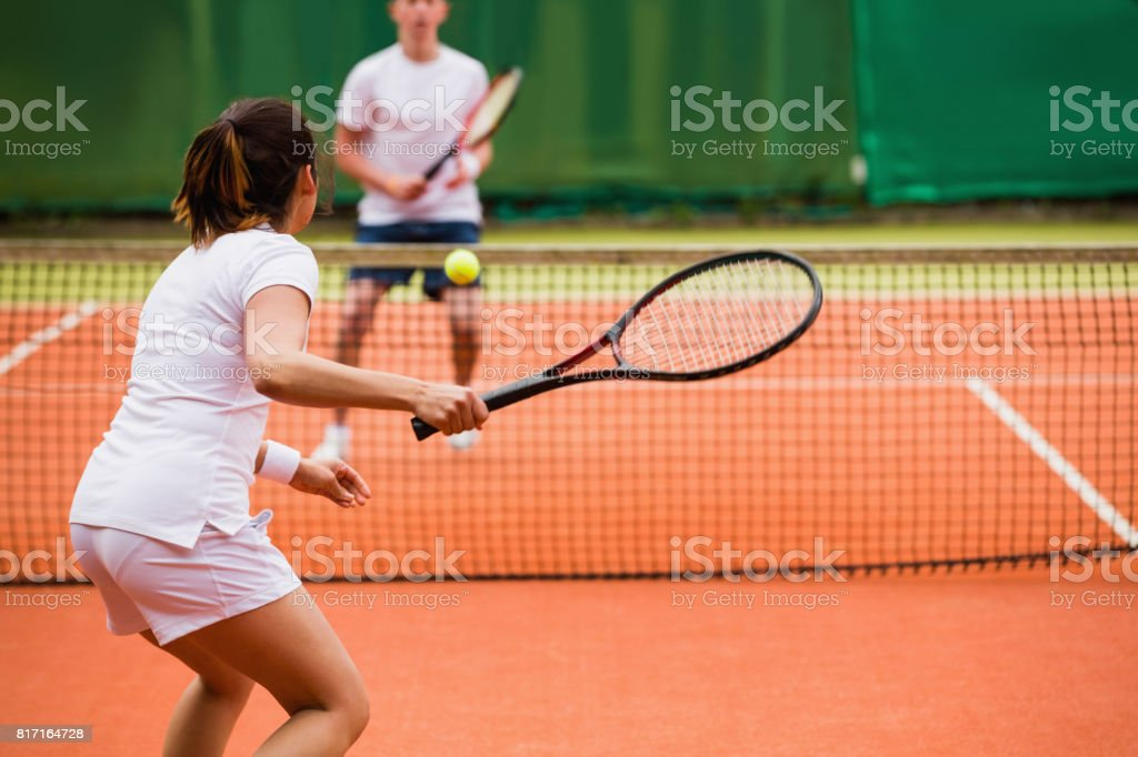 Tennis players playing a match on the court stock photo