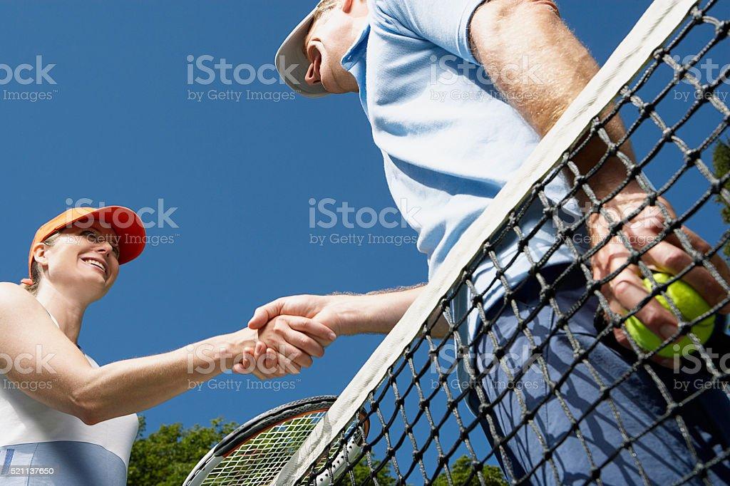 Tennis players shaking hands stock photo