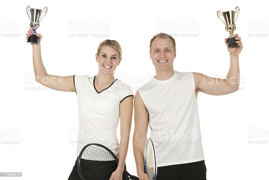 Tennis players with trophies royalty-free stock photo