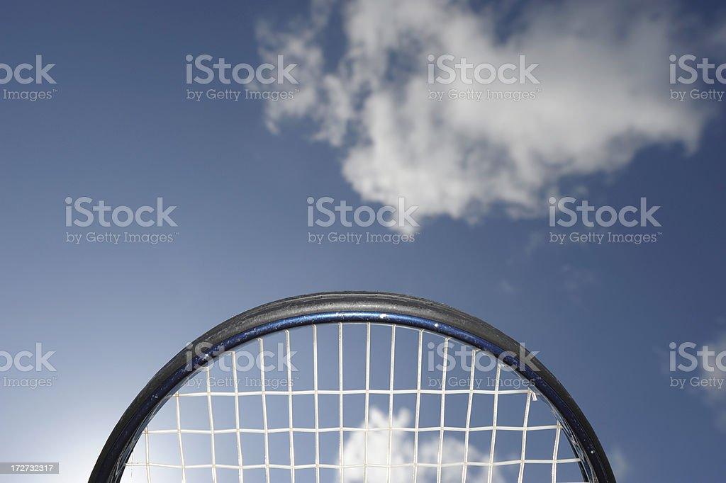 Tennis racket against blue sky royalty-free stock photo