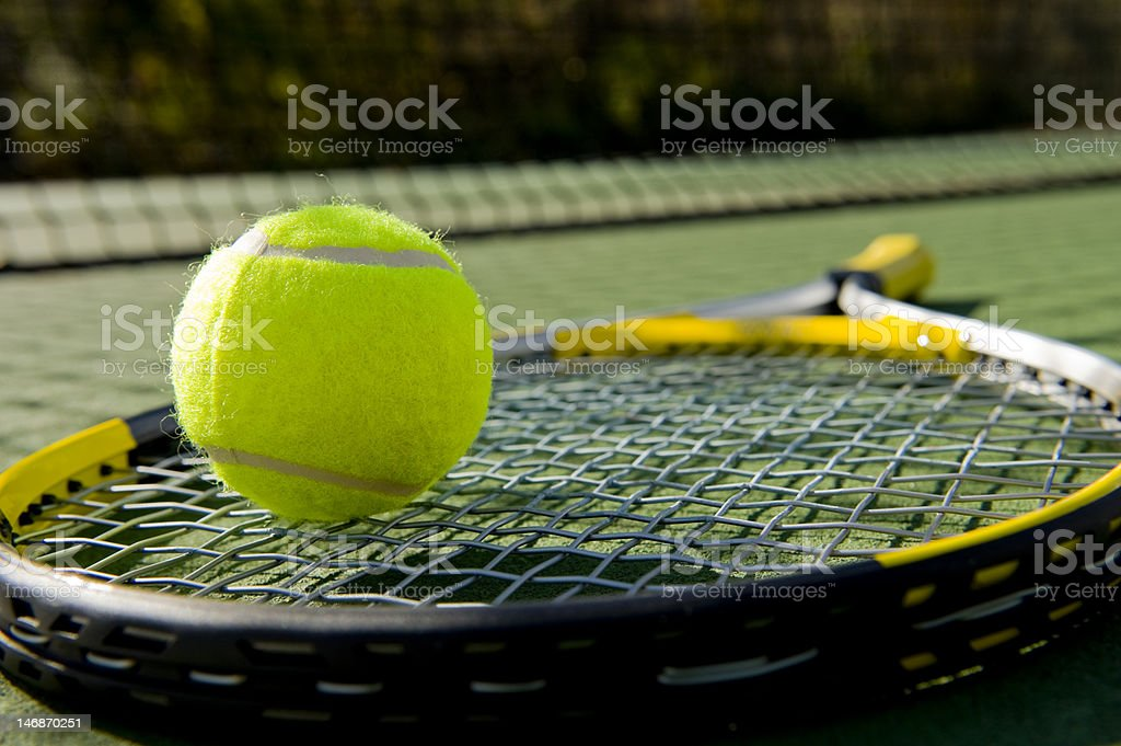 Tennis Racket and Ball on Court stock photo