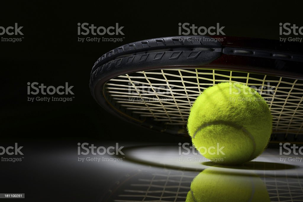 Tennis racket and ball on dark background stock photo