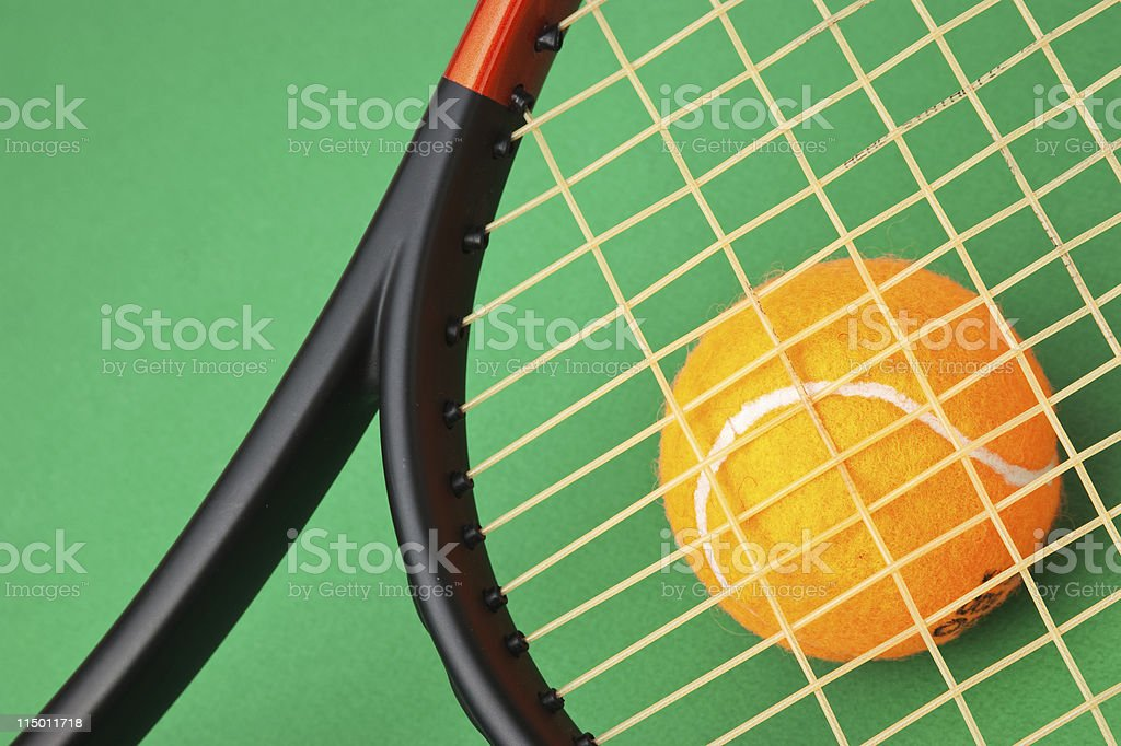 tennis racket and  ball on green background royalty-free stock photo