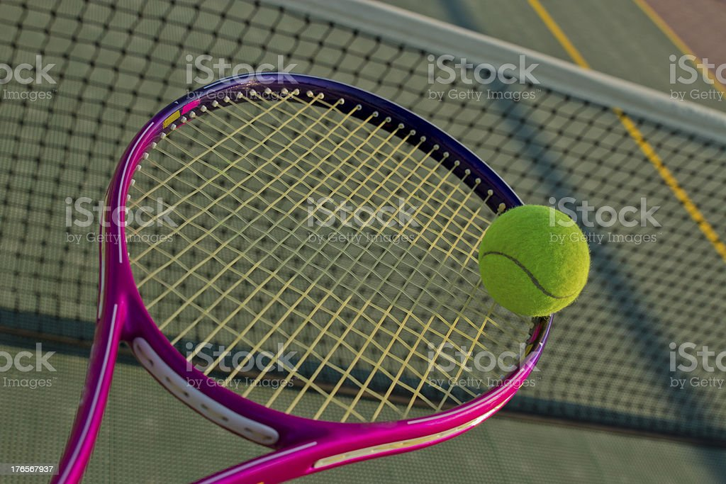 Tennis Racket And Ball Over The Net In Court royalty-free stock photo