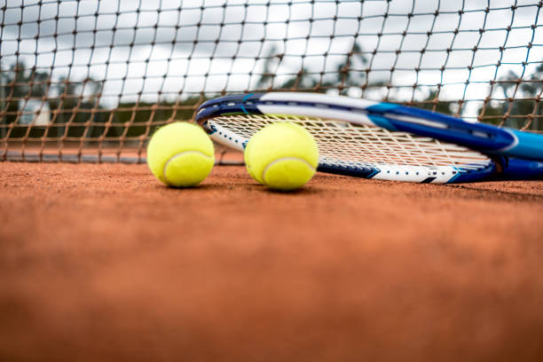 Tennis racket and balls at the court stock photo