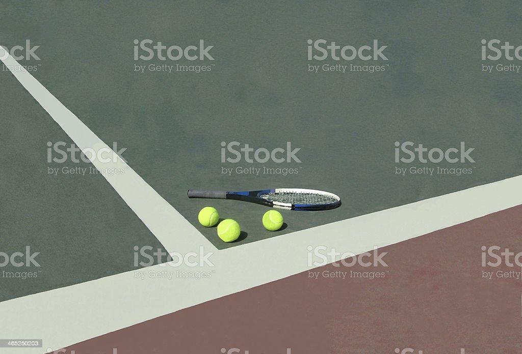 Tennis racket lying on a  ball near court line royalty-free stock photo