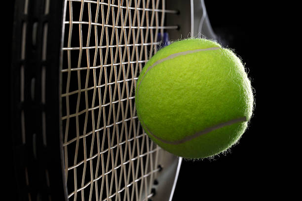 tennis racket with tennis ball stock photo