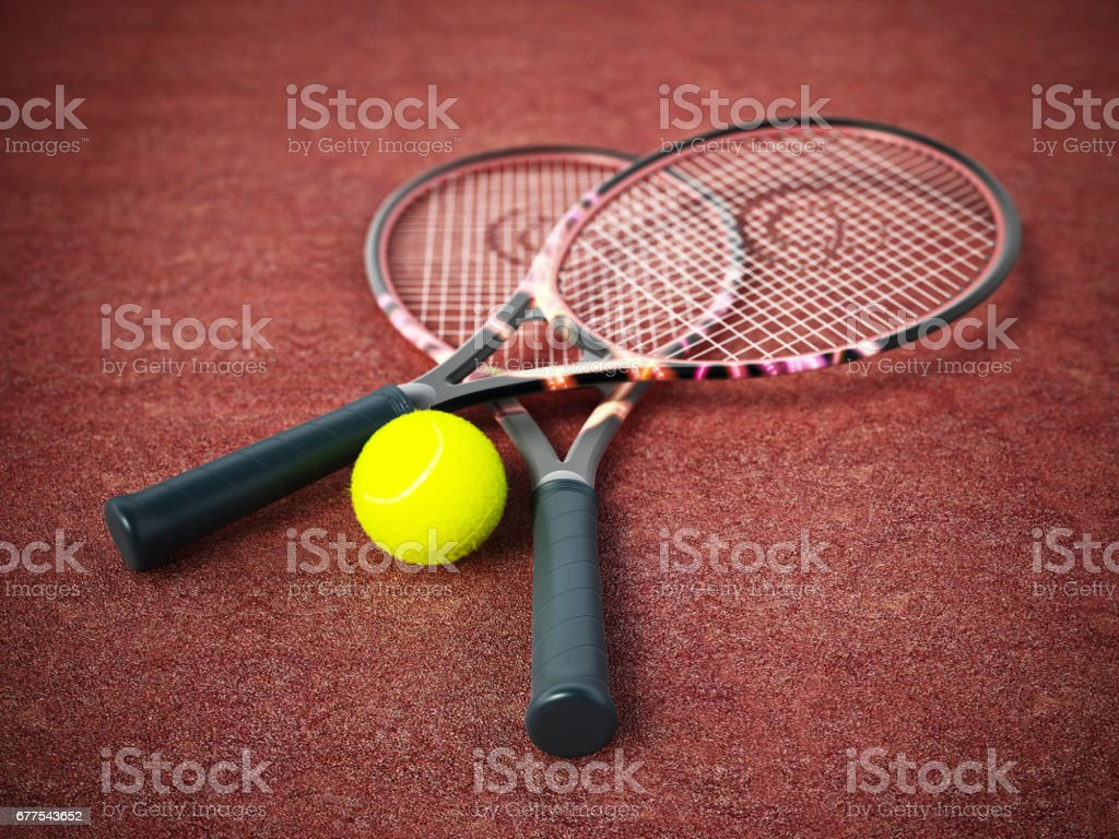 Tennis rackets and ball standing on clay surface royalty-free stock photo