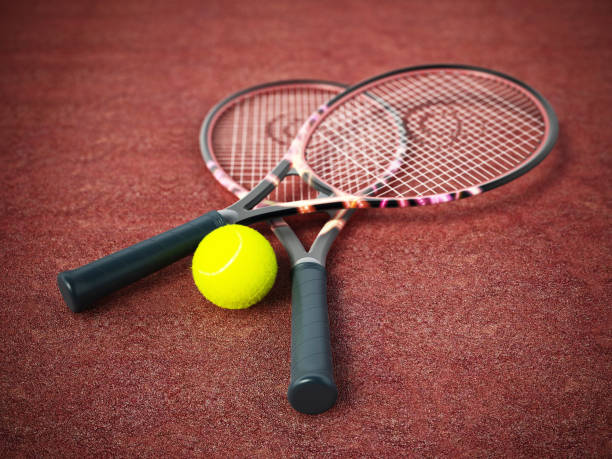 tennis rackets and ball standing on clay surface - icon set healthy foto e immagini stock
