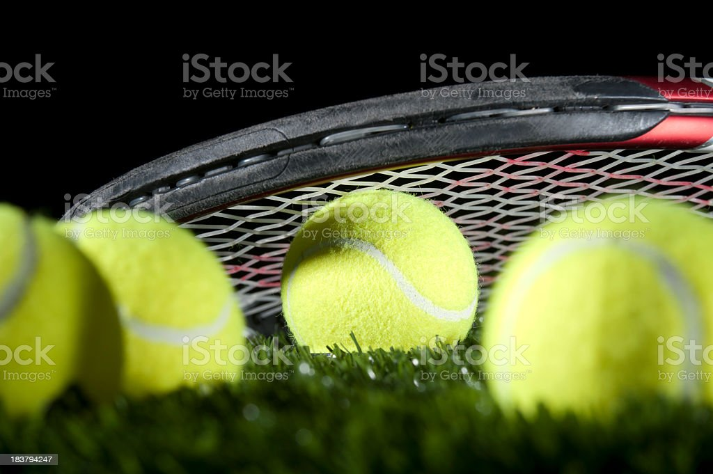 Tennis racquet and balls stock photo
