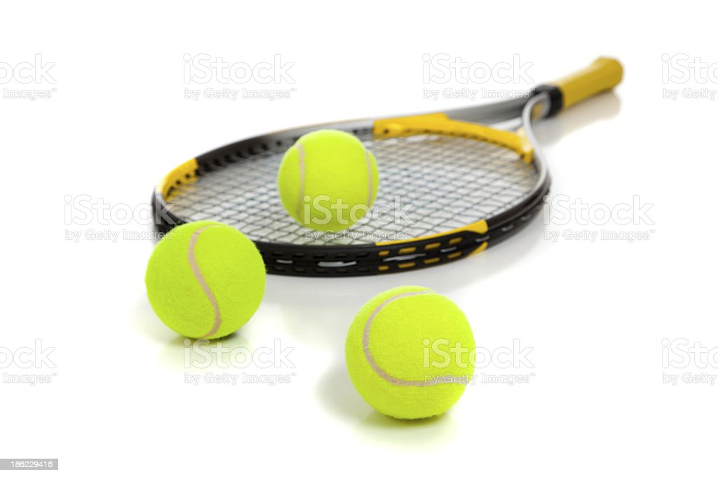 Tennis raquet with yellow balls on white stock photo