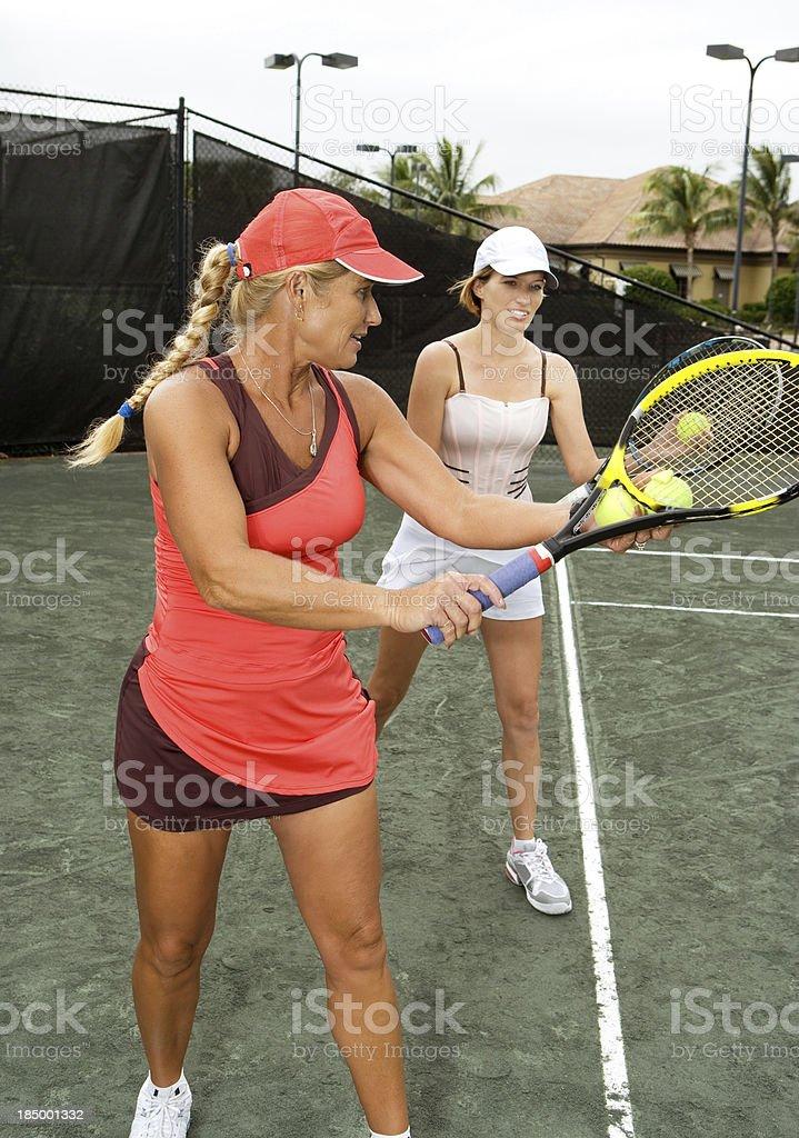 Tennis serve lesson stock photo
