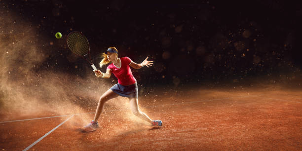 tennis: sportswoman in action - tennis stock photos and pictures