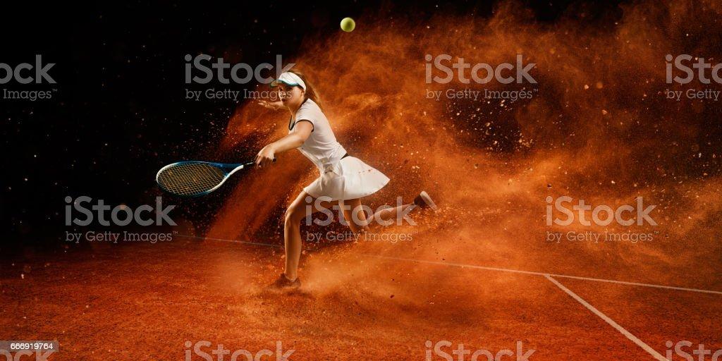 Tennis: Sportswoman in action stock photo