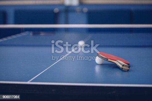 Table tennis equipement on tennis table, no people.