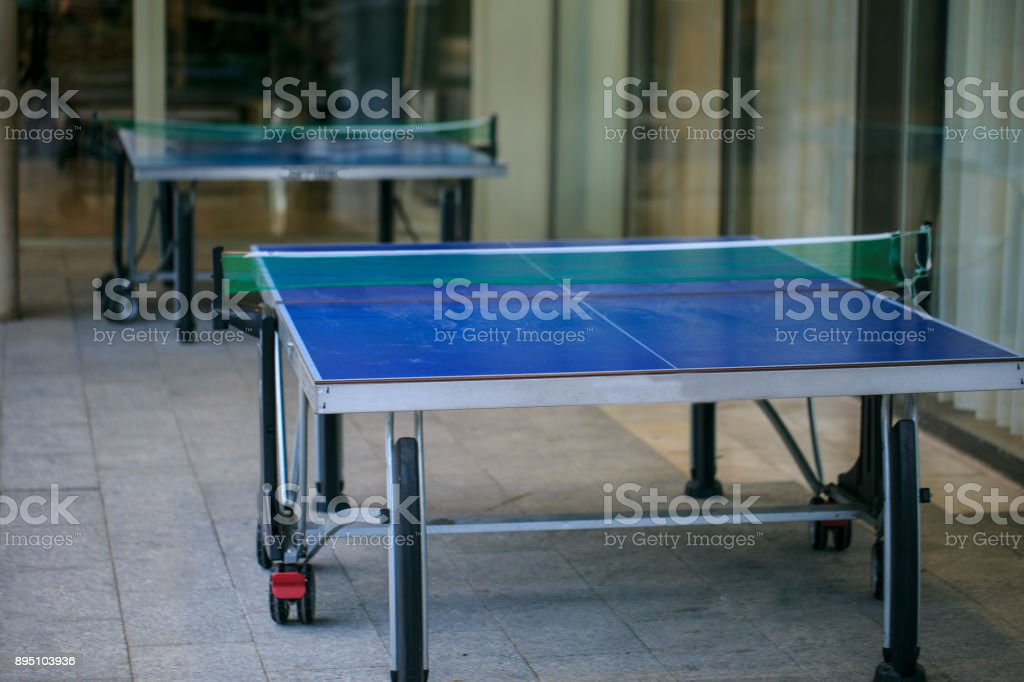 Tennis tables on the street stock photo