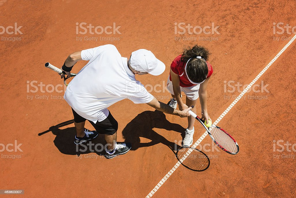 Tennis trainer training a young woman stock photo