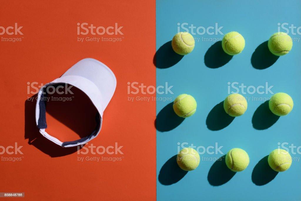 tennis visor and balls stock photo