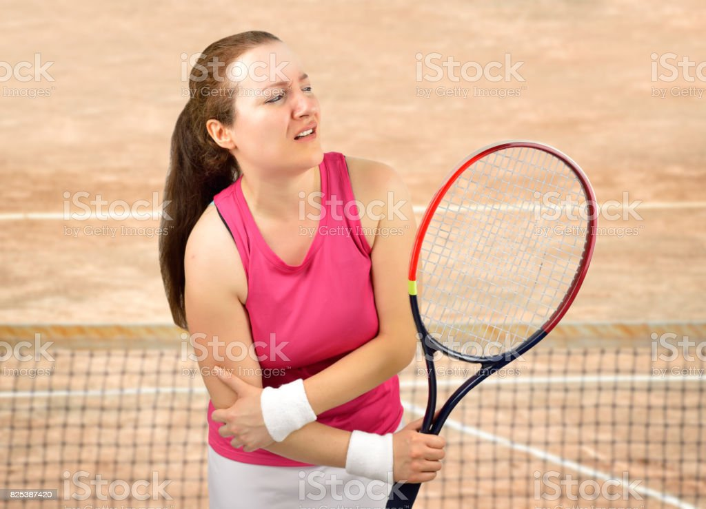 tennis woman player injured stock photo