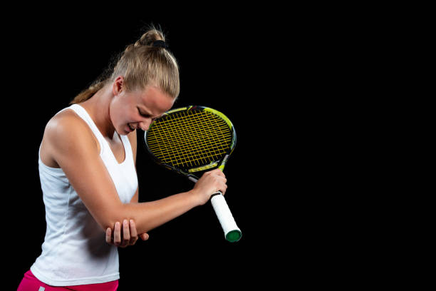 tennis woman player with injury holding the racket on a tennis court stock photo