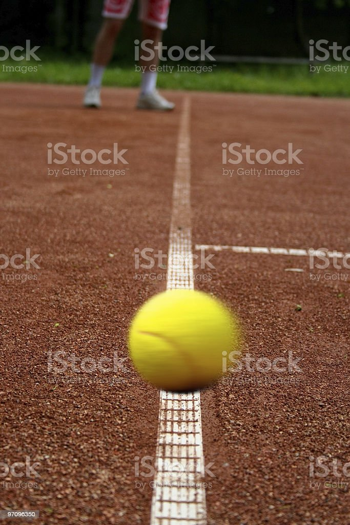 Tennisball on the playing field royalty-free stock photo