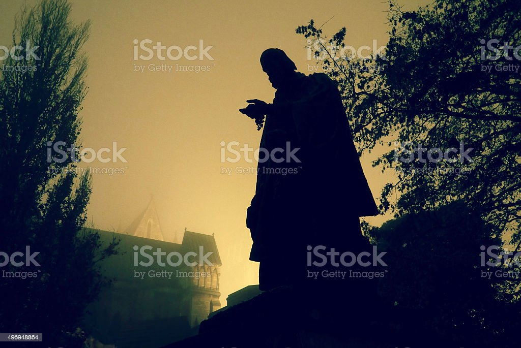 Tennyson Statue, Lincoln Cathedral at night in the fog stock photo