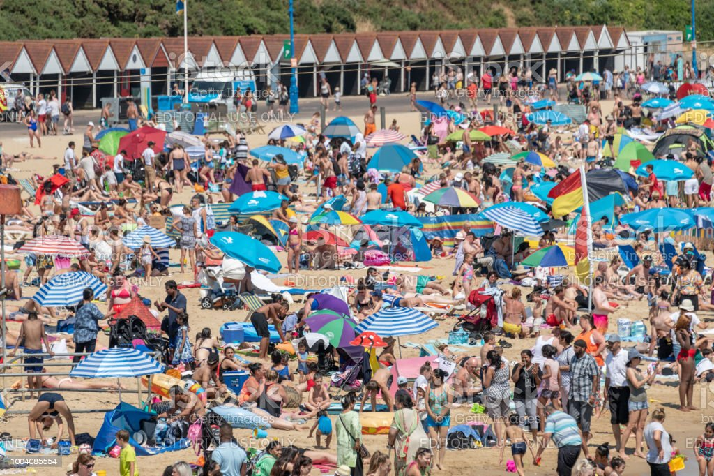 Tens of thousands of people crowd the beach in Bournemouth, UK stock photo