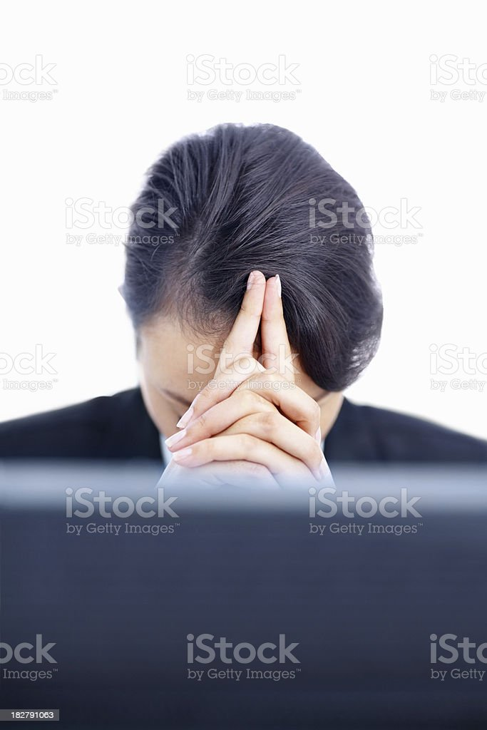 Tensed business woman with hands on head at desk royalty-free stock photo