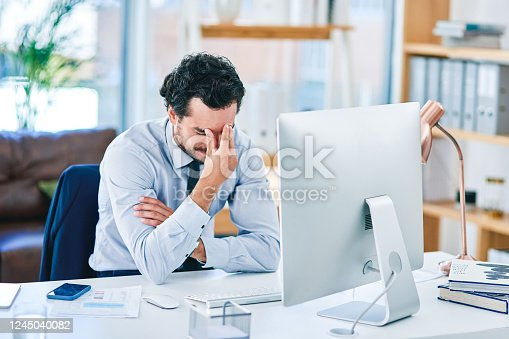 913327640 istock photo Tension headaches can quickly ruin your workday 1245040082