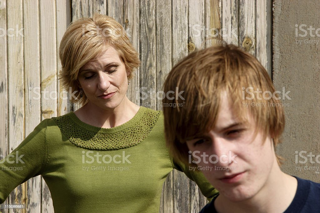 tension teen - middle aged woman with son royalty-free stock photo