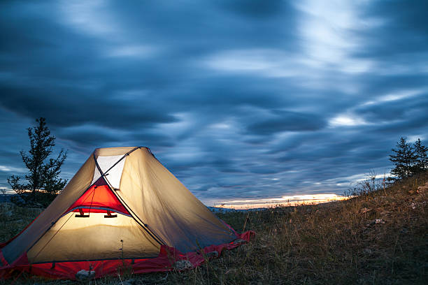 Tent against stormy clouds stock photo