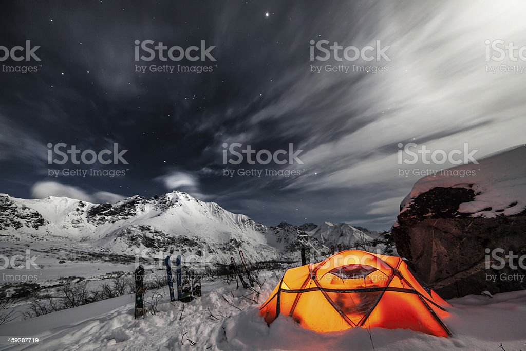 Tent among winter mountains. Stock image stock photo