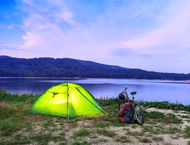 tent and bike - lakeshore stock photos and pictures