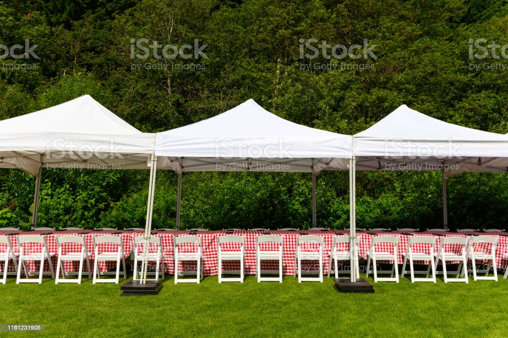 Outdoor picnic set up with table, chairs and table cloth for outdoor...