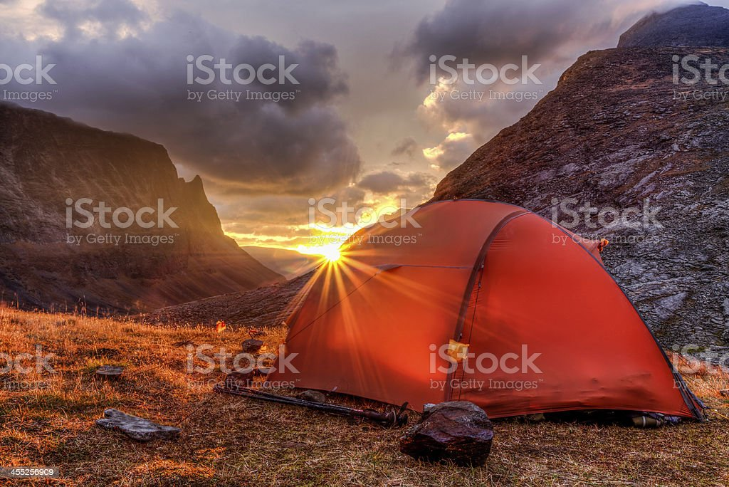 Tent and Sunrise in the mountains On a Trekking tour in the north of sweden at Sunrise. Swedish Lapland Stock Photo