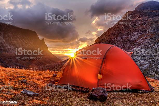 Tent And Sunrise In The Mountains Stock Photo - Download Image Now