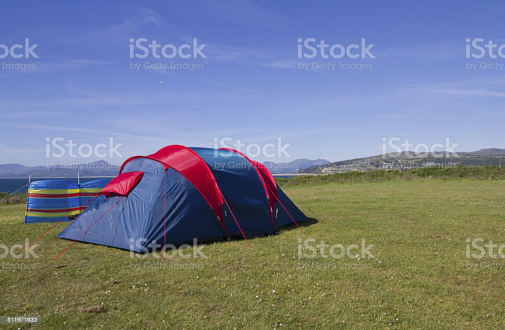 Tent and windbreak with views of the Welsh coast. stock photo