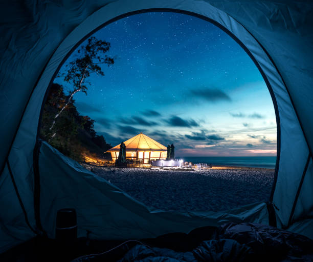 Tent at beach in summer at night with stars stock photo
