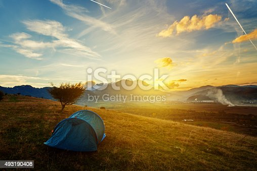 istock tent at sunset 493190408