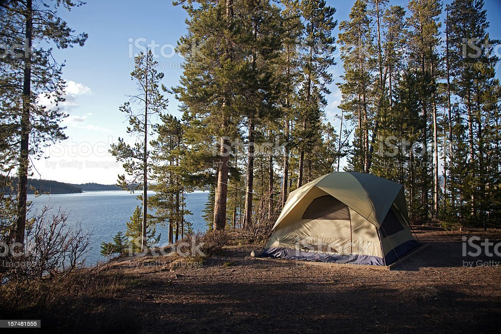 Tent by lake stock photo