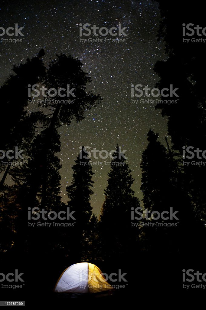 Tent camping below a starry sky stock photo